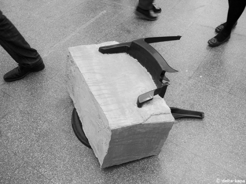 """How much does it take"", mass concrete and plastic chair. Sculpture from Nina Nowak at the class of Prof. Richard Deacon. Rundgang 2011, Kunstakademie Düsseldorf"